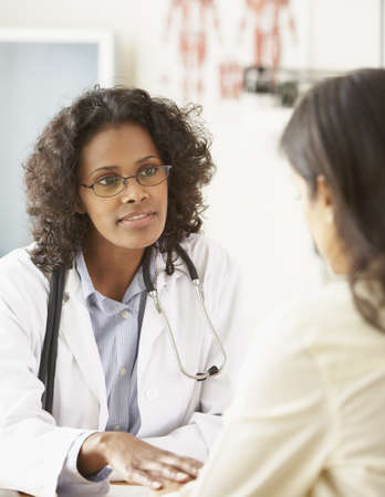 African female doctor talking to patient