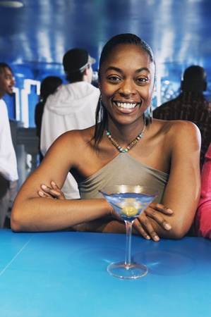 Portrait of African woman with cocktail