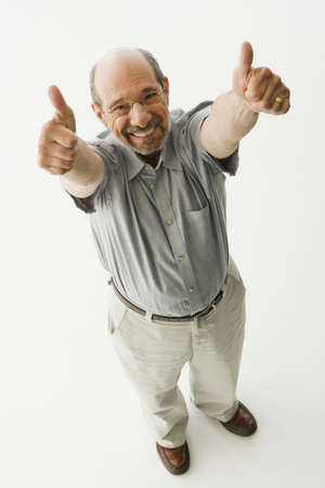 Senior man giving thumbs up with both hands LANG_EVOIMAGES