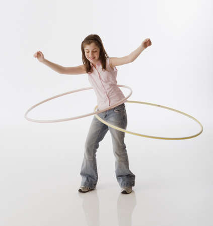 Greek girl playing with hula hoops LANG_EVOIMAGES