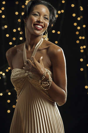 Portrait of African woman wearing evening dress