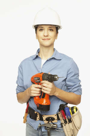 Hispanic female construction worker holding drill