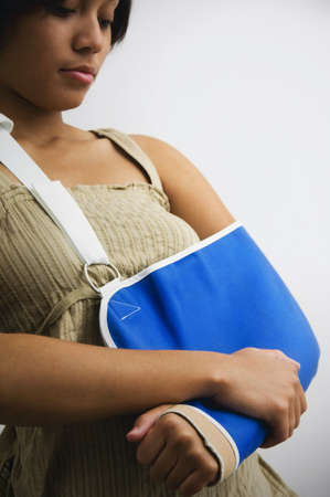 Young woman with arm in sling