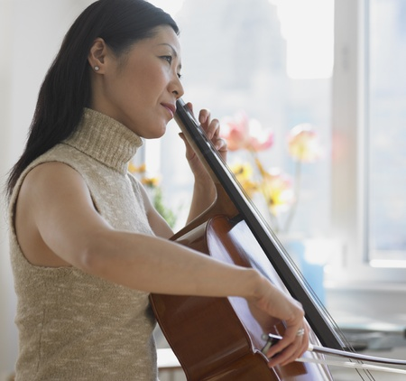 Asian woman playing cello