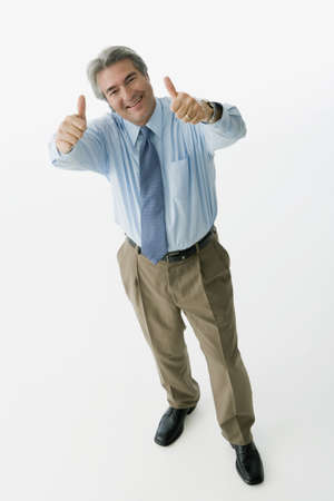 Hispanic man giving thumbs up LANG_EVOIMAGES