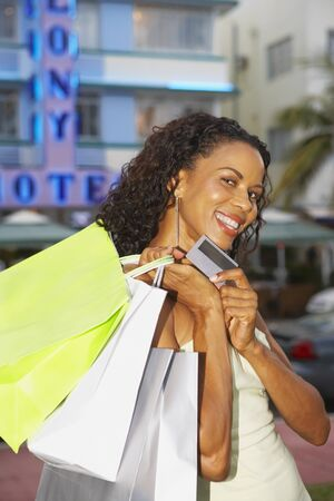 African woman carrying shopping bags LANG_EVOIMAGES