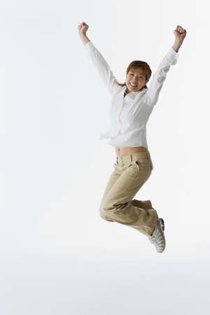 Asian woman jumping LANG_EVOIMAGES