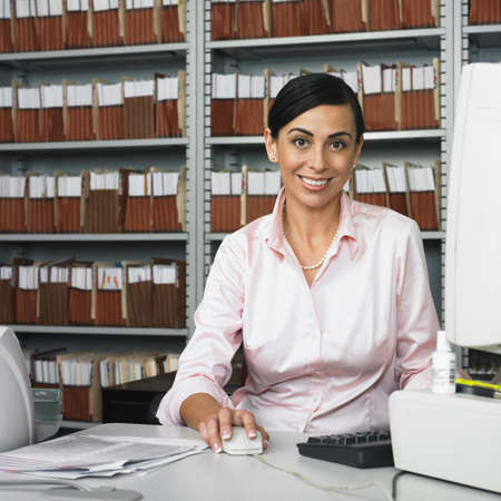 Hispanic businesswoman at computer