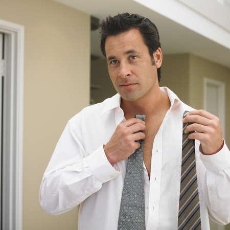 Man comparing neckties