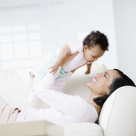 African American mother smiling at baby LANG_EVOIMAGES