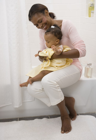 African American grandmother drying off baby LANG_EVOIMAGES