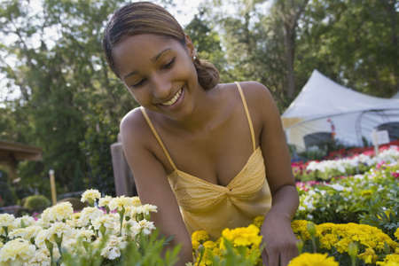 African woman at plant nursery LANG_EVOIMAGES