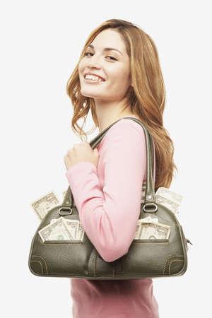 Hispanic woman with purse full of money
