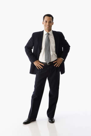 Hispanic businessman with hands on hips LANG_EVOIMAGES