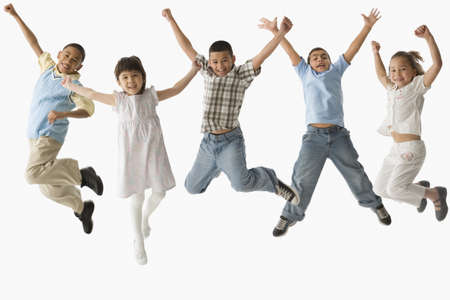 Multi-ethnic children jumping LANG_EVOIMAGES
