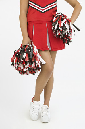Asian girl in cheerleading outfit