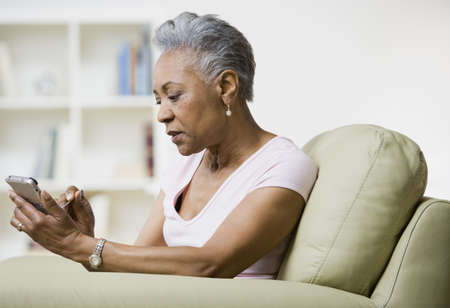 Senior African American woman using electronic organizer