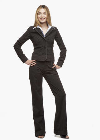 Hispanic businesswoman with hands on hips LANG_EVOIMAGES