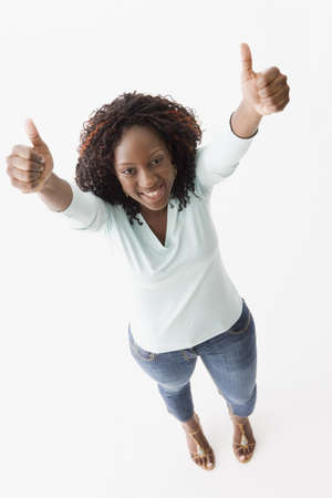 African American woman giving thumbs up LANG_EVOIMAGES