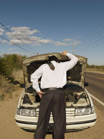 Hispanic man broken down on side of road