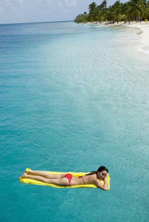 Woman on float in water