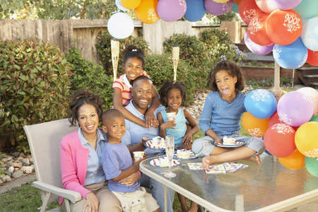 African American family celebrating birthday LANG_EVOIMAGES