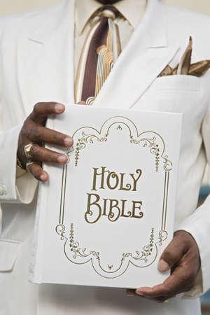Senior African American man holding Bible
