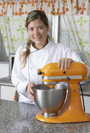 Hispanic female baker in kitchen
