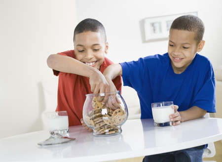 African American brothers reaching into cookie jar