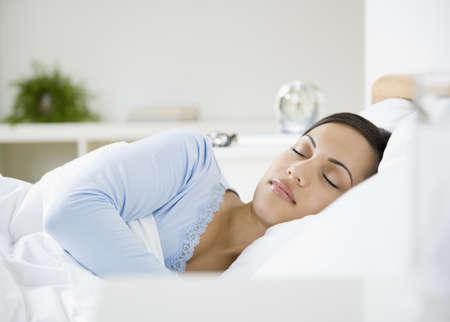 African American woman sleeping in bed
