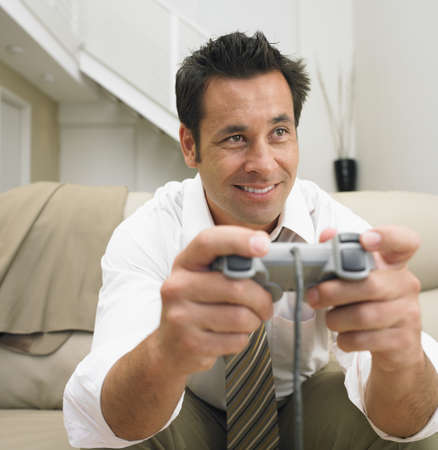 Businessman playing video games LANG_EVOIMAGES