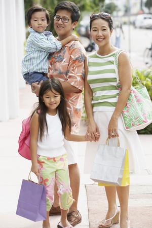 Asian family on sidewalk
