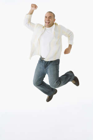 African American man jumping in air LANG_EVOIMAGES