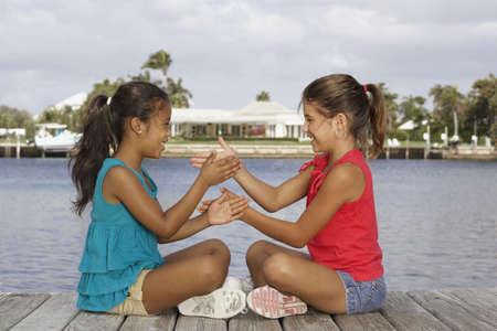 Mixed Race girls playing game