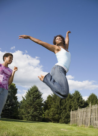 African American woman jumping