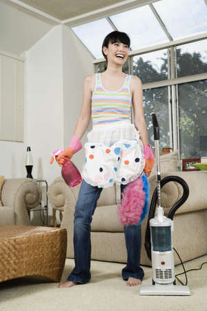 Asian woman with cleaning supplies
