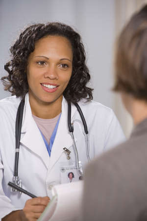 African American female doctor talking to patient LANG_EVOIMAGES