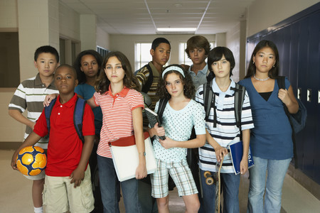 Group of multi-ethnic students in hallway LANG_EVOIMAGES
