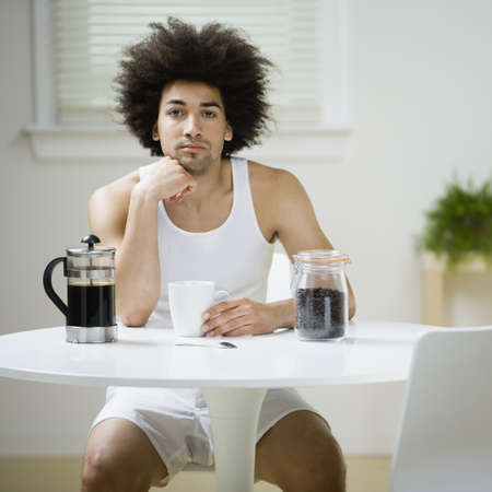 Mixed Race man having coffee LANG_EVOIMAGES