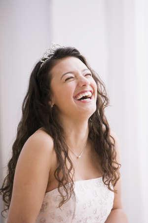 Hispanic teenaged girl wearing tiara
