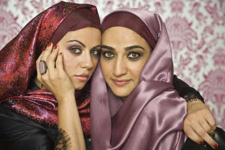 Middle Eastern women hugging LANG_EVOIMAGES