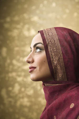 Middle Eastern woman wearing head scarf LANG_EVOIMAGES