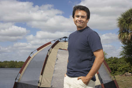 Hispanic man in front of tent