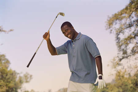 African American man holding golf club LANG_EVOIMAGES