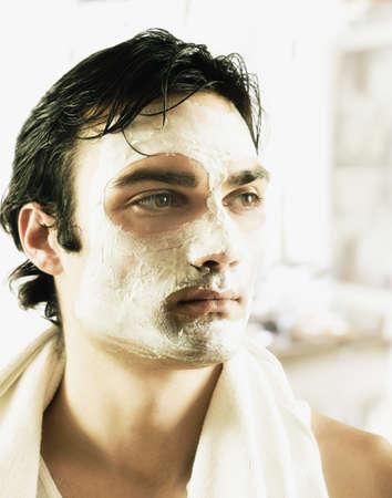 European man receiving spa facial treatment LANG_EVOIMAGES