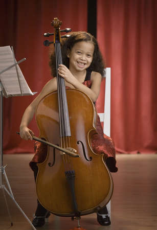 Mixed Race girl playing cello LANG_EVOIMAGES