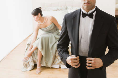 Hispanic couple in evening wear LANG_EVOIMAGES
