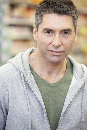 Hispanic man wearing sweatshirt