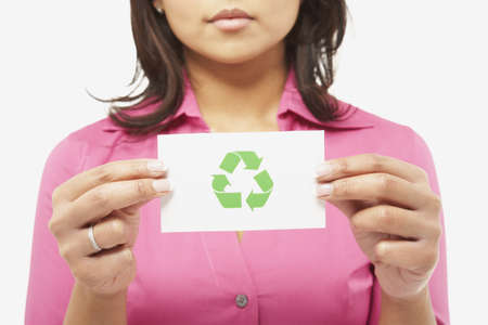 Asian woman holding recycling symbol