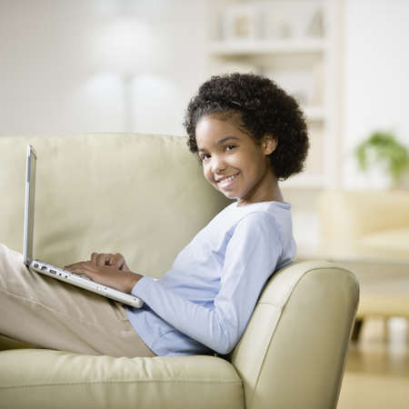 African girl typing on laptop